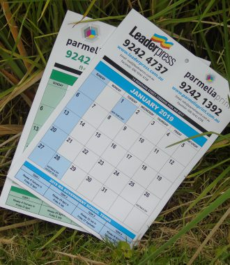 Printed Wall Calendar with drilled hole